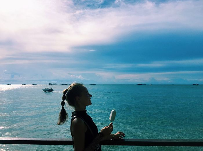 Sea Water Horizon Over Water Leisure Activity Tranquil Scene Lifestyles Tourism Tourist Scenics Tranquility Beauty In Nature Non-urban Scene Sky Vacations Side View Cloud - Sky Travel Destinations Enjoyment Nature Rear View Blue Girl