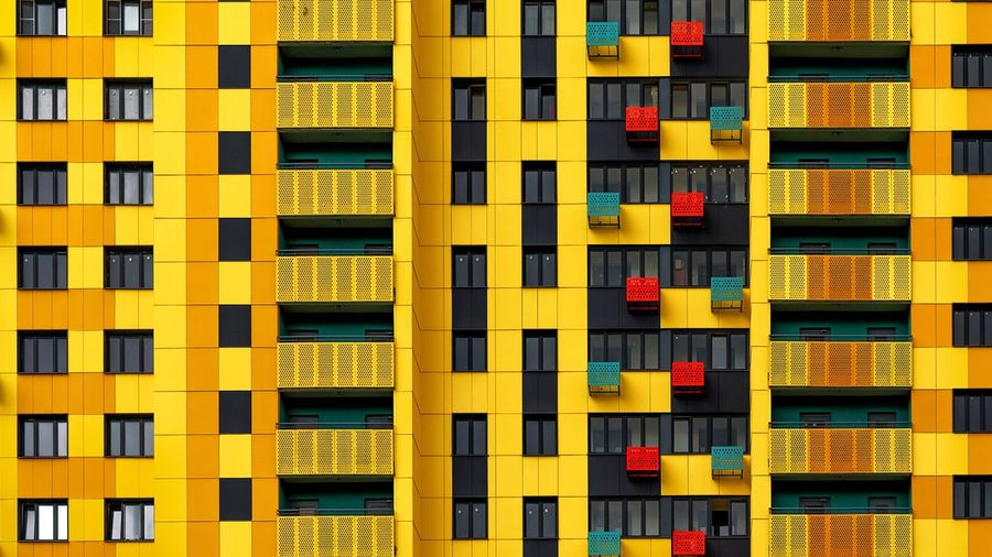 Architecture Full Frame Built Structure Backgrounds Building Exterior No People Window Building Residential District Yellow In A Row City Day Side By Side Outdoors Repetition Apartment Pattern Modern Multi Colored