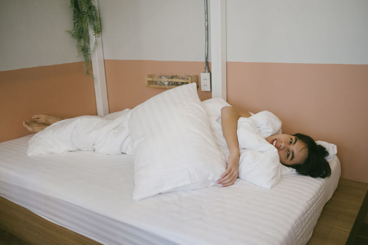 Portrait of woman sleeping at home