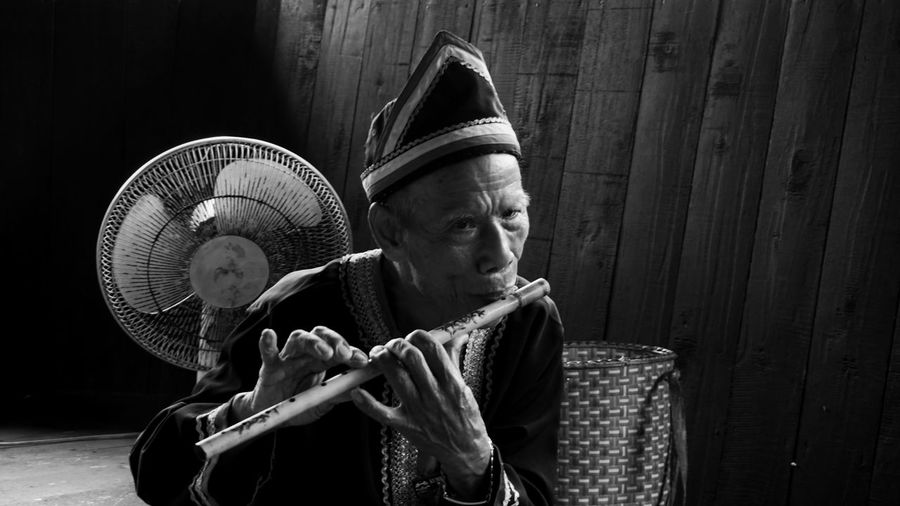 Portrait of man playing flute
