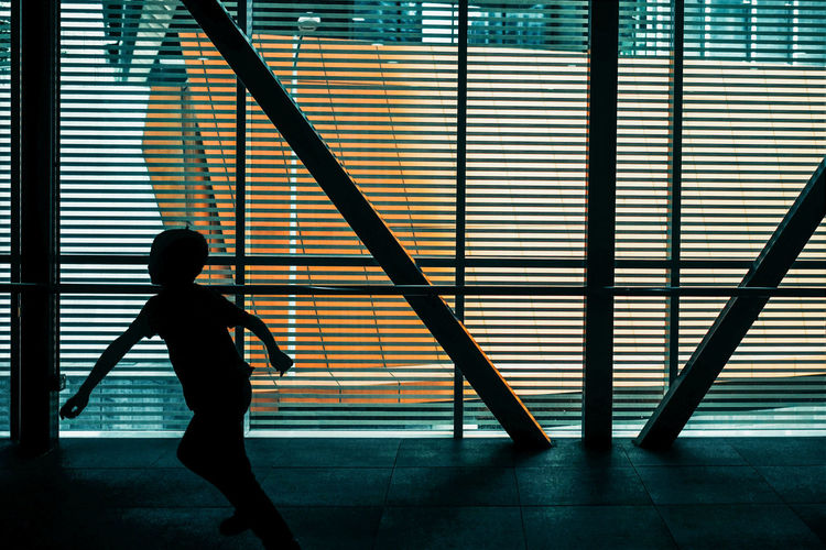 Travel City Silhouette Real People One Person Architecture Indoors  Full Length Lifestyles Standing Built Structure Railing Men Childhood Walking Staircase Wall - Building Feature Boys Leisure Activity Day Child Flooring Street The Architect - 2019 EyeEm Awards