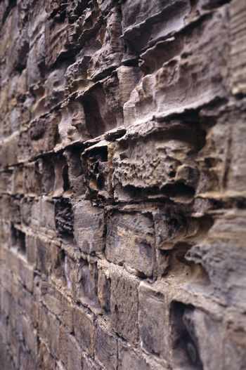 soft sandstone brick pattern - narrow depth of field Brick Building Building Exterior Eroded Erosion Erroded Old Old Ruin Rock Rough Stone Stone Wall Textured  Wall Wathered Wind Blowing  Worn