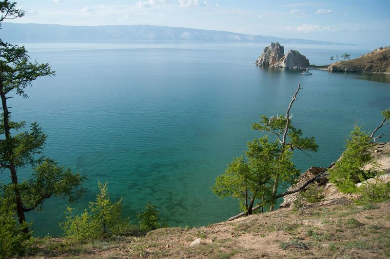 Baikal lake Shamanka rock Baikal Russia Shamanka Rock Baikal Baikal Lake Bay Beauty In Nature Day Idyllic Lake Landscape Mountain Mountain Range Nature No People Outdoors Plant Scenics Shamanka Sky Tranquil Scene Tranquility Tree Water