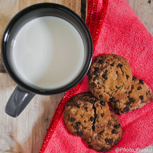 Baked Chocolate Chip Chocolate Chip Cookie Close-up Cookie Day Drink Food Food And Drink Freshness Homemade Indoors  No People Raisin Ready-to-eat Red Sweet Food Table