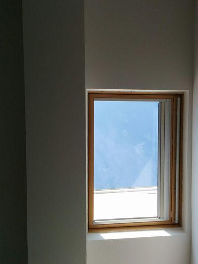 Sky seen through glass window