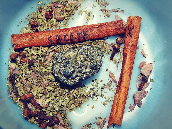 manifest success Wealth Runes Prosperity Luck Fortune Good Cloves From Above  Manifestation Spell Pagan Witch Green Magic Success Herbs Attraction Stone Bowl Cinnamon Close-up Star Anise Spice
