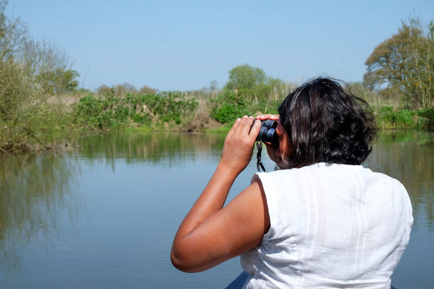 Kayaking LokkoPac Activity Binoculars Bird Watching Casual Clothing Day Digital Camera Holding Leisure Activity Lifestyles Looking Through An Object Men Modern Nature One Person Outdoors Photographer Photographing Real People Standing Technology Waist Up Water