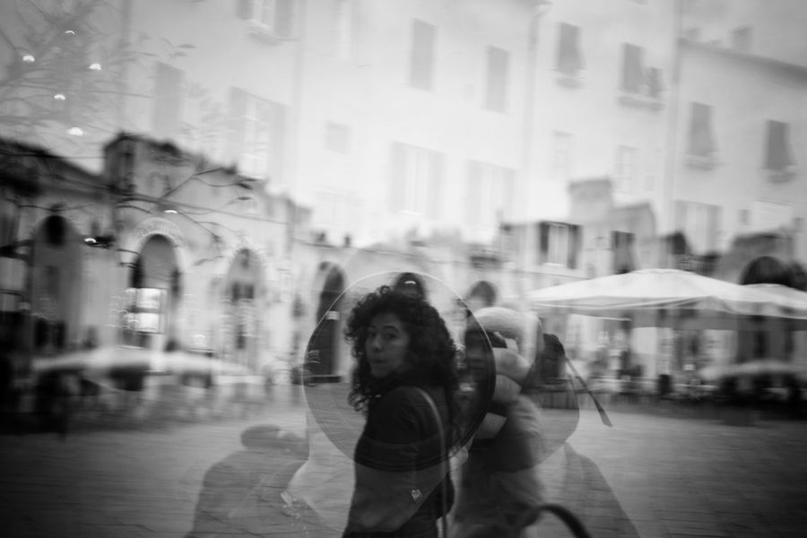 Got caught! B&w Street Photography Streetphotography Showcase: December Lucca Italy Streetphotography Urbanphotography Piazza Girl Looking At Camera Photographic Memory The Tourist The Street Photographer - 2016 EyeEm Awards The Street Photographer – 2016 EyeEm Awards
