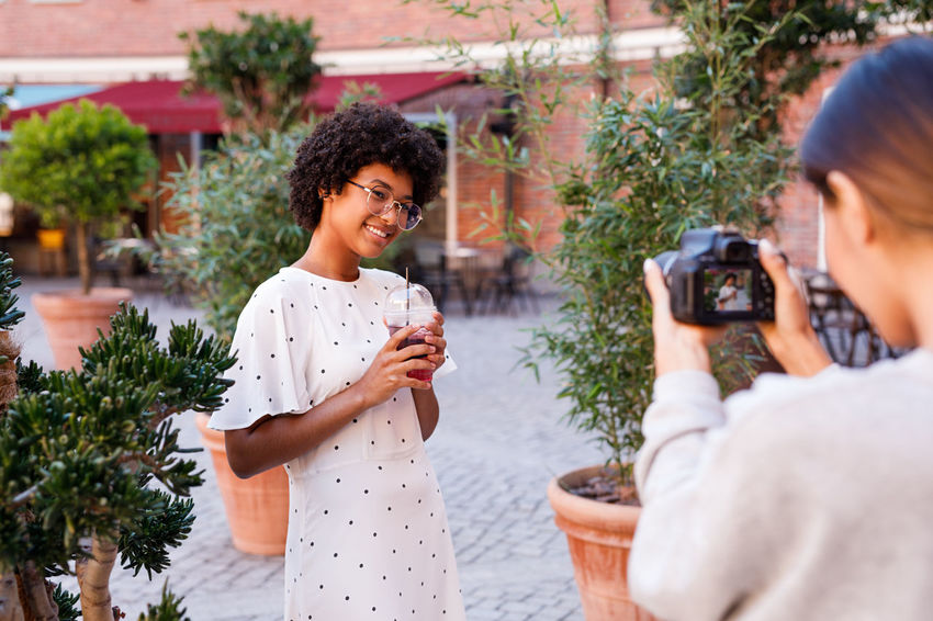 Woman Blogger Vlogger Photography Streaming Vacation Shooting Looking Social Media Girl Outdoors Online  Drink Lifestyle Young African American Camera Holding Females One Person Real People Photographing Photographer