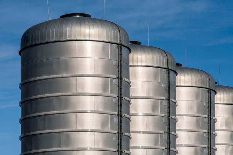 Business Gas Gasoline Industrial Industry Production Alloy Architecture Built Structure Container Day Factory Food And Drink Industry Low Angle View Metal Nature No People Outdoors Silo Silver Colored Sky Stainless Steel  Steel Storage Compartment Storage Tank Sunlight Tank Technology