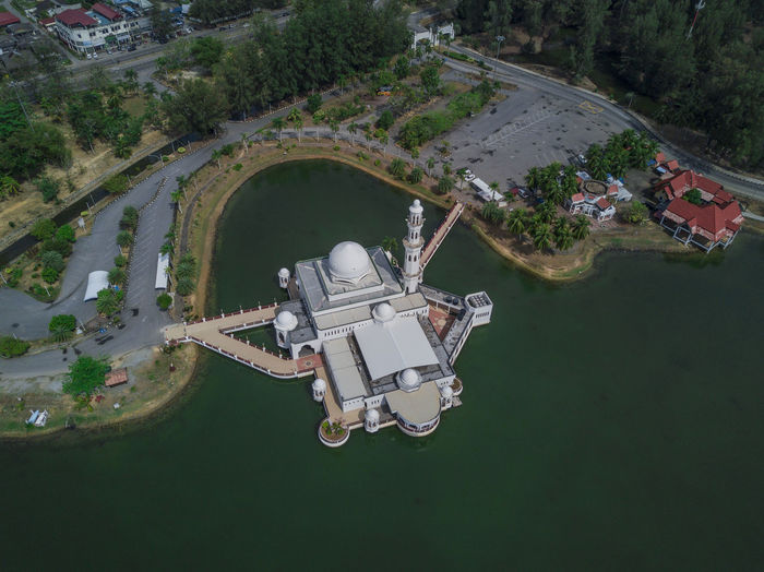 Aerial view of Tengku Tengah Zaharah Mosque Bird's-eye View Aerial View Air Vehicle Architecture Building Exterior Built Structure Day Drone Photography Floating Mosque Flying High Angle View Mid-air Motion Nature No People Outdoors Plant Travel Travel Destinations Water White Mosque