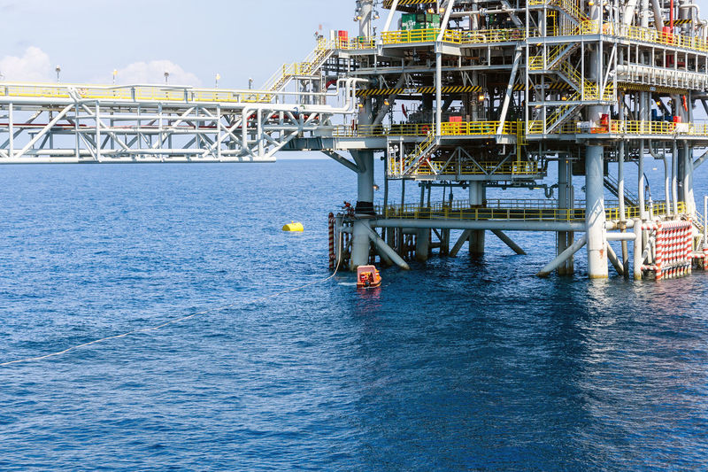 A fast rescue craft being deployed next to an oil production platfoem at oil field