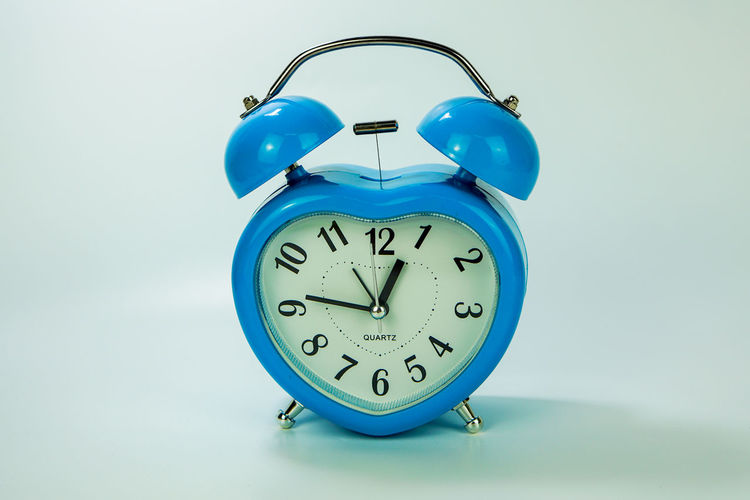Close-up of clock against blue background