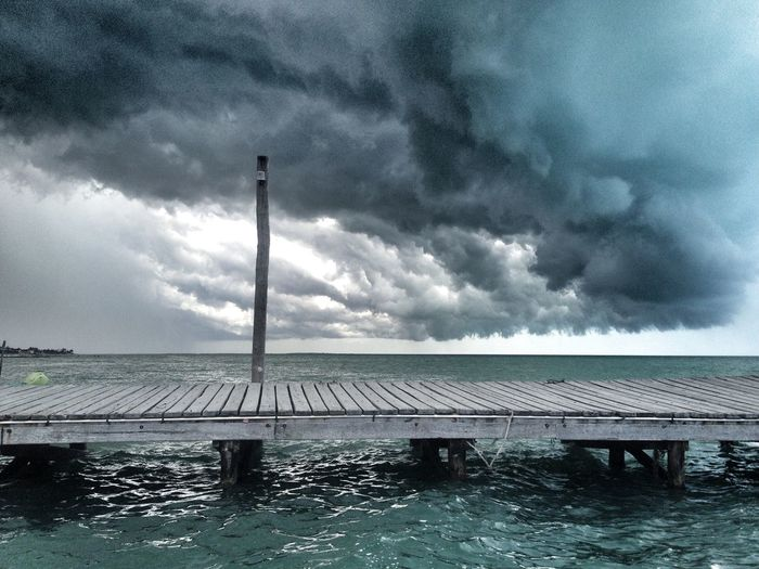 Cloud - Sky Sky Water Storm Nature Storm Cloud No People Overcast Beauty In Nature Built Structure Sea Day Architecture Waterfront Outdoors Scenics - Nature Pier Thunderstorm Power In Nature Swimming Pool Extreme Weather Ominous Storm Nature Landscape Mexico Island