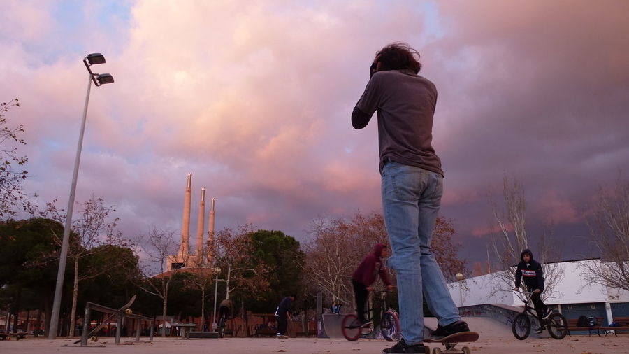 Barcelona Streetlife Urban Life, Life In Motion, Street Life, Architecture, Architecture Boards Casual Clothing Factory Boys Factory Building Lifestyles Light And Shadow Outdoors Real People Rear View Sunset Urbanphotography Young Adult