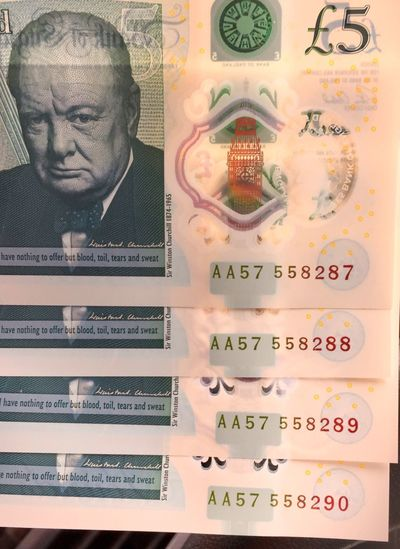 They came out of the cash machine in number order. They will never be together again. It's like breaking up a family. Text Human Representation Western Script Culture Focus On Foreground Memories Full Frame Facial Expression Cash Cashmoney  £ Five Pound Note Plastic Money