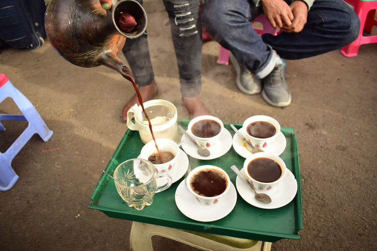 Coffee break Coffee Time Coffee Coffee - Drink Coffee Cup Crockery Cup Drink Food Food And Drink Freshness Glass Hand High Angle View Hot Drink Human Body Part Men Mug Pouring Real People Refreshment Table Tea Tea - Hot Drink Tea Cup Teapot The Street Photographer - 2018 EyeEm Awards