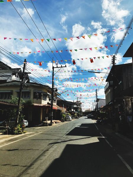 Sky Built Structure Architecture Cloud - Sky Building Exterior Street Cable Day Road The Way Forward Sunlight Outdoors Bunting No People City Telephone Line Nature