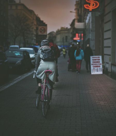Transportation Land Vehicle Bicycle Mode Of Transport Architecture Real People City Rear View Built Structure Men Building Exterior Street Outdoors Full Length City Life Women Riding One Person Road Day EyeEm Best Shots The Week On Eyem EyeEm Gallery EyeEm Best Edits Neon Life