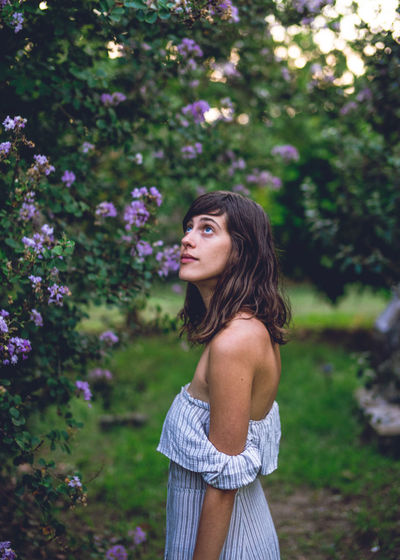 Beautiful Nature Beautiful Woman Beauty In Nature Day Daydreaming Flower Flowers Flowers_collection Focus On Foreground Girl Holiday Leisure Activity Lifestyles Love Lovely Girl One Person Outdoors Purple Real People Standing Travel Travel Photography Tree Lost In The Landscape Connected By Travel A New Beginning International Women's Day 2019
