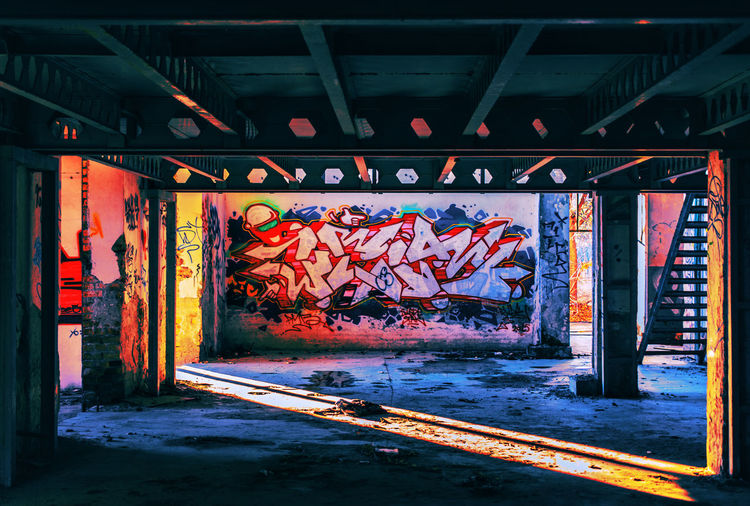 Graffiti on bridge by building