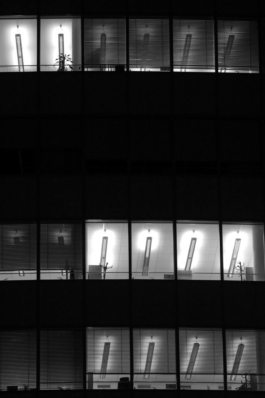 illuminated, night, text, communication, walking, indoors, real people, architecture, men, airport, built structure, building exterior, people