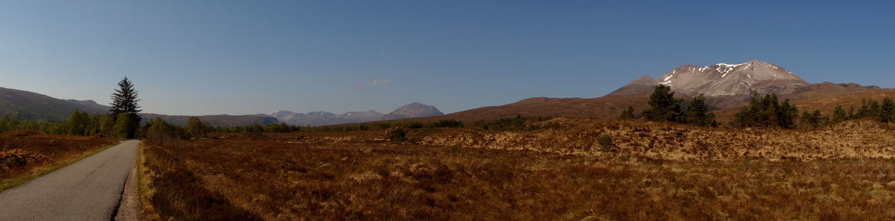 Panoramic View Beauty In Nature Day Landscape Mountain Mountain Range Nature No People Outdoors Road Scenics Sky Torridon Mountains Torridon Road Tree Wilderness