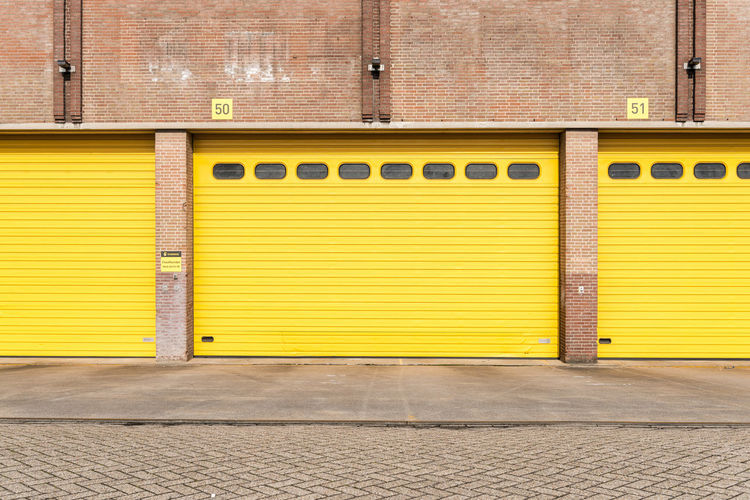 Closed Yellow Shutter Of Garages