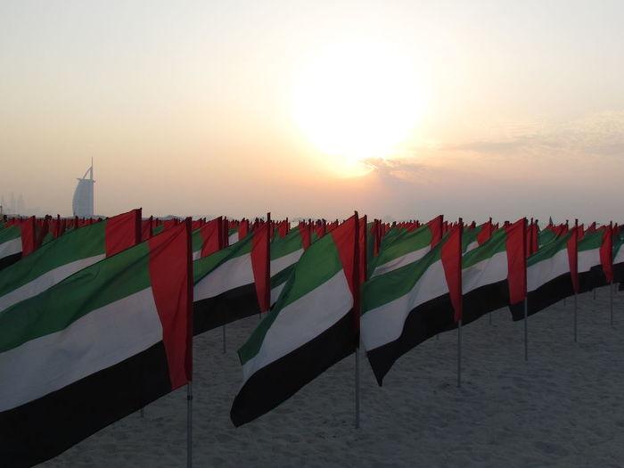Burj Al Arab Burjalarab Flag Identity Jumeirah Jumeirahbeach National Day National Flag Outdoor Outdoors Pole Sign Striped Sunset Symbol UAE UAE NATIONAL DAY UAE NationalDay Celebration Wind