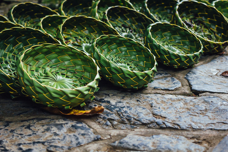 High Angle View Of Leaf Baskets On Paving Street