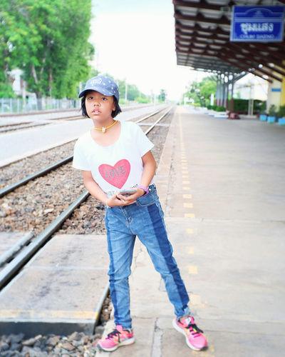 Full length portrait of girl standing in city
