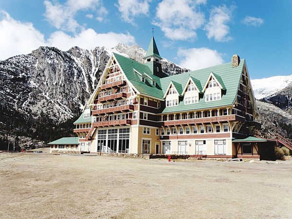 Mountain Travel Architecture Travel Destinations Sky Building Exterior Landscape City Outdoors Mountain Range Tradition Tower History Built Structure Cloud - Sky Snow No People Business Finance And Industry Scenics Tree Prince Of Wales Hotel Waterton National Park Alberta Canada 🇨🇦