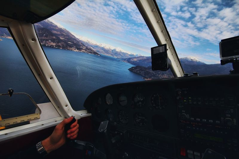 Lago di Como ✈️🛸 Landscape Italy Lake Como Lake Airplane Cockpit Vehicle Interior Transportation Air Vehicle Flying Dashboard Sky Pilot One Person Cloud - Sky Day Mode Of Transport Human Hand Aerial View Piloting Real People Human Body Part Sea Mid-air
