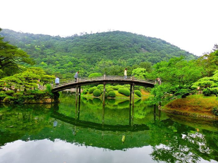 Hi! Hello World Taking Photos Day Sky Water Reflection Outdoors Green Color Holiday Destination Reflection Cultures Beauty In Nature Nature Enjoying Life Japan Photography Check This Out The Great Outdoors - 2017 EyeEm Awards Bridge Bridge View Japan 香川 高松 栗林公園
