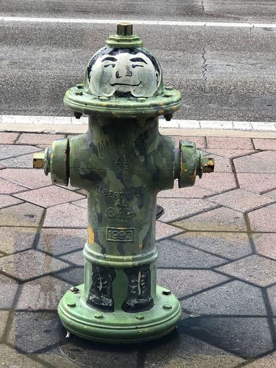 Close-up of fire hydrant on sidewalk
