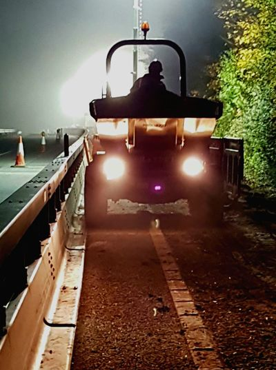 Illuminated Construction Workers Road Outdoors Protective Workwear Night Backlit.