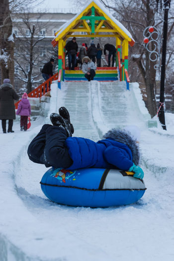 Winter Cold Temperature Full Length Child Blue Snow Childhood Outdoors Children Only Offspring People Vacations Warm Clothing One Person Architecture Day Adult Tradition Holiday - Event Vibrant Color Multi Colored Winter