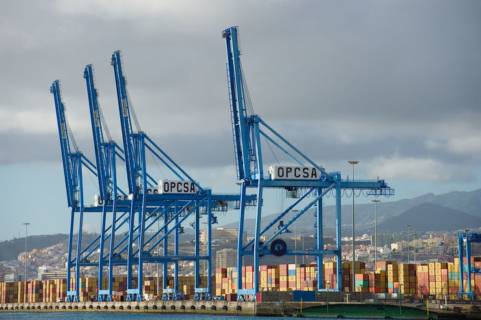 Container terminal with loading bridges in Las Palmas Container Bridges Containership Crane - Construction Machinery Harbour Las Palmas (puerto) Logistics Shipping  Worldwide Trade