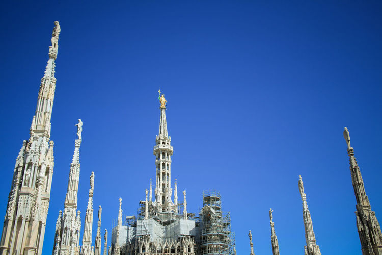 Blue sky above spires of Duomo cathedral in MIlano, Italy Blue Blue Sky Blue Sky Milano Duomo Duomo Spires Madunina Milano Milanocity No People Outdoors Spire  Spires Tourism Travel Destinations