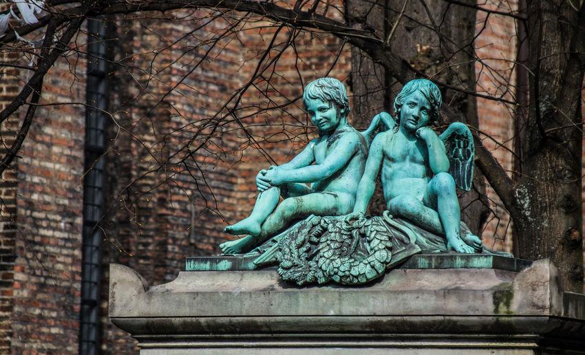 Angel sculptures against building