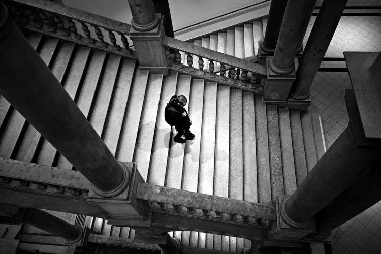 Technische Universität Wien Adult Adults Only Architecture Architecture Black And White Built Structure Day From Above  Indoors  Light And Shadow Low Angle View One Person People Railing Real People Staircase Stairs Vienna Wien