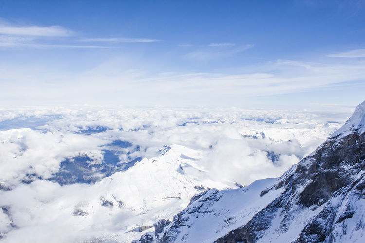 Snow Scenics - Nature Cold Temperature Cloud - Sky Beauty In Nature Winter Sky Mountain Tranquil Scene White Color Tranquility Environment No People Day Non-urban Scene Nature Mountain Range Snowcapped Mountain
