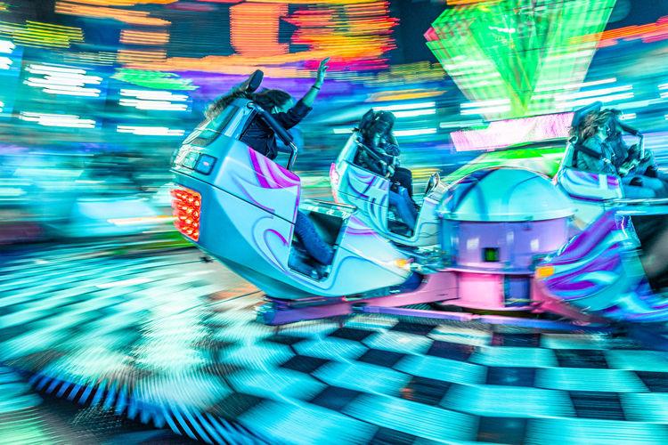 Illuminated ferris wheel at amusement park
