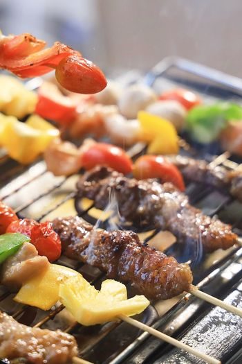 Close-up of food on barbecue grill