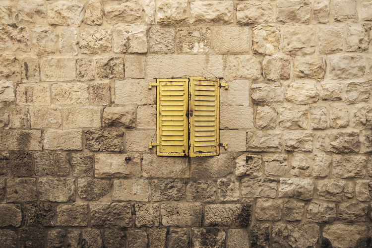 Built Structure Wall Wall - Building Feature Architecture No People Brick Brick Wall Day Building Exterior Pattern Textured  Yellow Stone Wall Close-up Outdoors Full Frame Stone Material Backgrounds Air Duct Window Middle East Yellow Wall Wall Windows Window Frame Windows_aroundtheworld Travel Destinations Architecture Old Wall Ancient Closed Brick Wall Little Centre Rust Paint Israel Minimalism Minimal