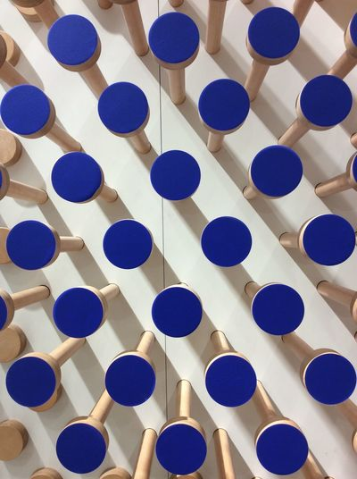 Blue dots circles wooden shop display Painted Blue Pegs in relief Shadow No People Close-up Modern Hanging Textured  March 2017 EyeEm Best Shots I Pad Photography Pattern Repetition Pattern I Pad Mini Textured Shop Wall Canada Eaton Centre Toronto