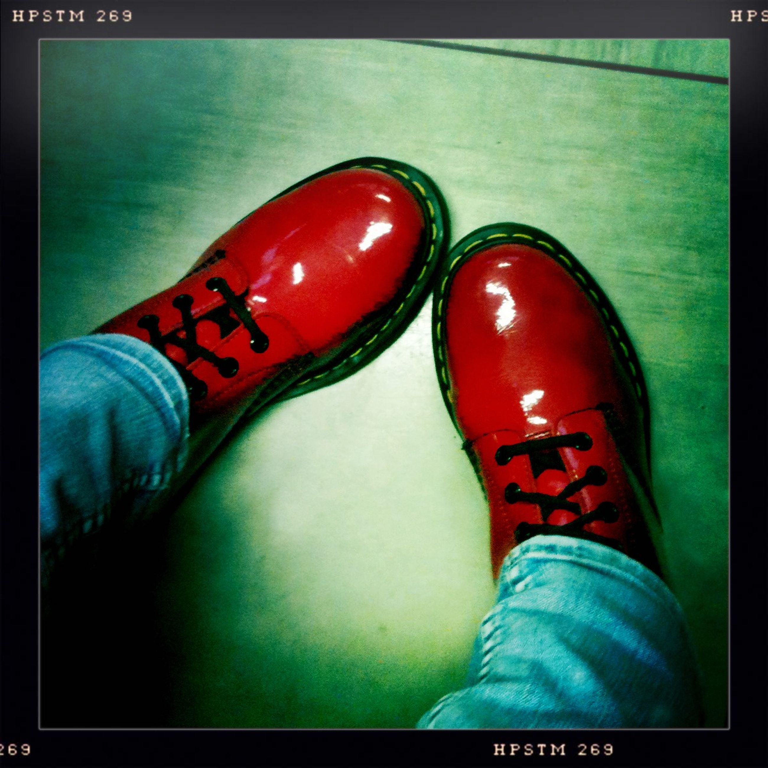 low section, person, shoe, transfer print, personal perspective, footwear, human foot, auto post production filter, canvas shoe, red, jeans, pair, standing, indoors, high angle view, lifestyles, close-up