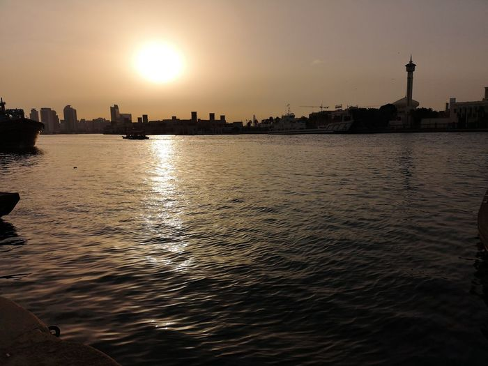 Water Cityscape Politics And Government Urban Skyline Sunset City Lake Beach Nautical Vessel Silhouette Low Tide Romantic Sky