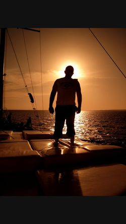Sunset Sea Silhouette One Person Men Adult One Man Only Sport Only Men Adults Only Healthy Lifestyle People Real People Outdoors Sky Vacations Beach Nature Beauty In Nature Water