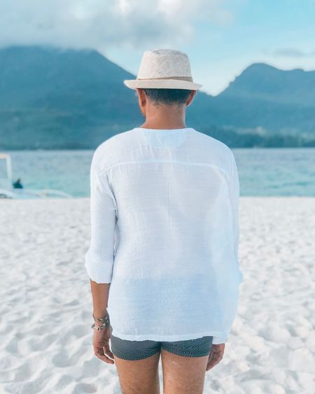 White shirt at the beach. Traveler Traveling White Island Camiguin Tourist White Shirt White Tshirt White White Color EyeEm Selects Beach Water Land Sea Three Quarter Length One Person Rear View Real People Holiday Leisure Activity Trip Vacations Standing Lifestyles Casual Clothing Day Clothing Sand Focus On Foreground Outdoors